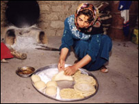 Kurdish woman prepares bread