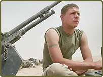 Cpl. Benjamin Webster of Columbus, Ohio, gunner for a US Marine tank
