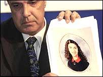 Commander Andy Baker with a school portrait of Heshu Yones