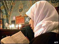 Turkish woman reads the Koran in a mosque