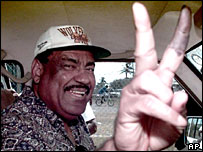 Lester Bird gestures peace sign after casting his vote in 1999 election