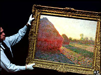 Auctioneer handles one of Claude Monet's haystack paintings