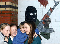 Girls and IRA mural, Belfast 