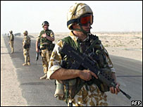 British soldiers patrolling road in Basra, Iraq, 2003