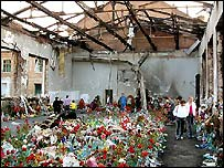 Flowers cover the floor of the school gym, Beslan