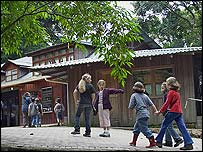 Local school children walking through the entrance to the Monteverde Reserve (Photograph by Brett Cole)