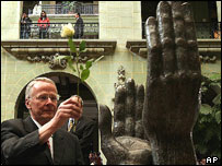 UN special representative places rose on peace monument, Guatemala City, 2004