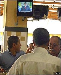 Brazilian President Luiz Inacio Lula da Silva is seen on a television screen in Rio de Janeiro