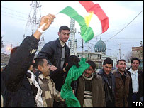 Iraqi Kurds celebrate in Kirkuk, February 2005, after announcement of election results