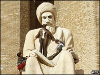 Boys clamber over statue of Kurdish poet Ibn Moustafa, Irbil