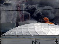 Flames erupt from the BP Amoco oil refinery in Texas City after the explosion