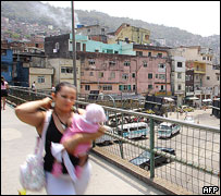 Woman crosses footbridge in Rocinha shantytown, Rio de Janeiro 