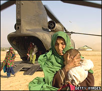 Kashmir quake survivors arrive at temporary camp in Mansehra, Pakistan, Oct 2005