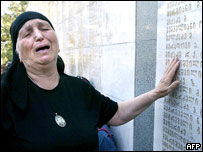 Woman cries at memorial in Tbilisi dedicated to Georgians killed in Abkhaz conflict