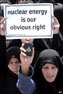 Women hold copy of Koran and sign at earlier nuclear protest near Isfahan, Iran
