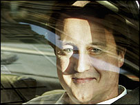 David Cameron photographed from outside a car