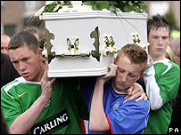 Friends of Michael McIlveen carry his coffin