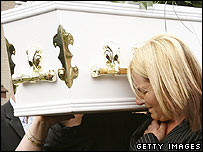Michael's mother Gina carrying his coffin