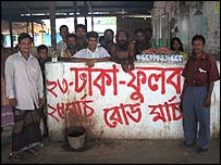 People standing against anti-mine graffiti in Phulbari in Bangladesh