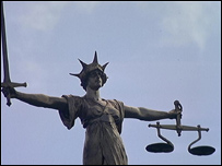 Old Bailey statue on the top of the law court showing the Scales of Justice