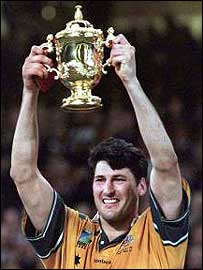 John Eales raises the Webb Ellis trophy at the Millennium Stadium in 1999