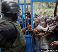 Haitian voters try to enter polling station, February 2006