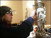 Restorer works on a fluvial goddess statue