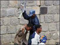 Policeman and student protesters, Addis Ababa, June 2005