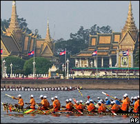 boats speed by Royal Palace, Phnom Penh, Cambodia, 2006