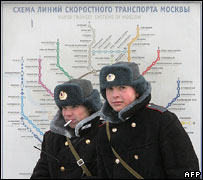 Policemen and map of Moscow metro