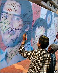 India cricket fans signing on a 'good luck' wall for the team