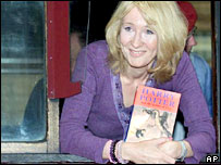 JK Rowling with a copy of Harry Potter and the Goblet of Fire
