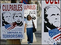 A billboard in Havana depicts US President Bush and anti-Castro militant Luis Posada Carriles