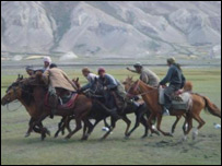Buzkashi players on horseback