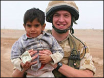 Joshua with an Iraqi child - Photograph courtesy of Charlie Harrison