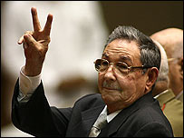 Raul Castro giving a victory sign in the Cuban National Assembly