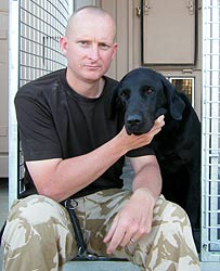 Sergeant Major Frank Holmes with sniffer dog