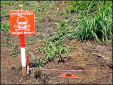 A landmine sign, next to a mine that will be destroyed in Boeung Prolite