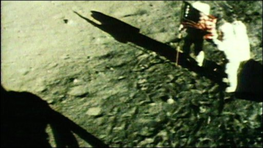 Armstrong and Aldrin raise US flag