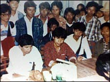 Aung Din (seated, red shirt) at a student's union meeting in March 1989. To his left is Min Ko Naing, the union's chairman, who is now in jail. (Image: US Campaign for Burma)