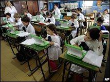 schoolchildren with XOs