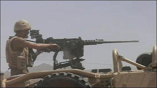 British soldier aiming a gun