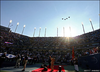 Military planes fly over Arthur Ashe Stadium before the start of the men's final between Andy Murray and Roger Federer