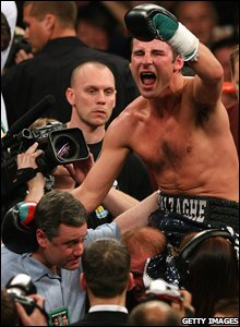 Joe Calzaghe celebrates his controversial points victory over Hopkins
