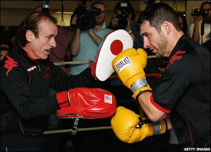 Joe Calzaghe is put through his paces by father and trainer Enzo ahead of his clash with Roy Jones Jr in New York