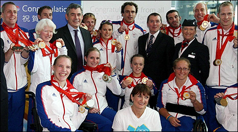 Gordon Brown met GB team members at Heathrow airport