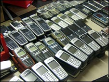 Rows of old mobile phones