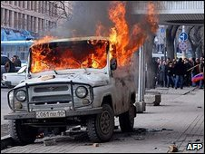 A vehicle burns in Yerevan, spring 2008