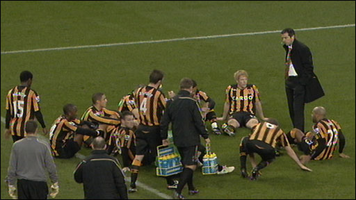 Brown gives half-time team talk on pitch