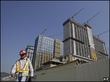 A worker walks in front of the construction site of Sheraton Macao Hotel on the Cotai strip in Macau, 13 Nov 2008